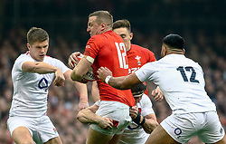 Hadleigh Parkes of Wales under pressure from Manu Tuilagi of England<br /> <br /> Photographer Simon King/Replay Images<br /> <br /> Six Nations Round 3 - Wales v England - Saturday 23rd February 2019 - Principality Stadium - Cardiff<br /> <br /> World Copyright © Replay Images . All rights reserved. info@replayimages.co.uk - http://replayimages.co.uk