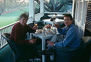 Photographer and author Louie Psihoyos with John Knoebber enjoying the clubhouse at Augusta National Golf Club, home of the PGA Masters Tournament.