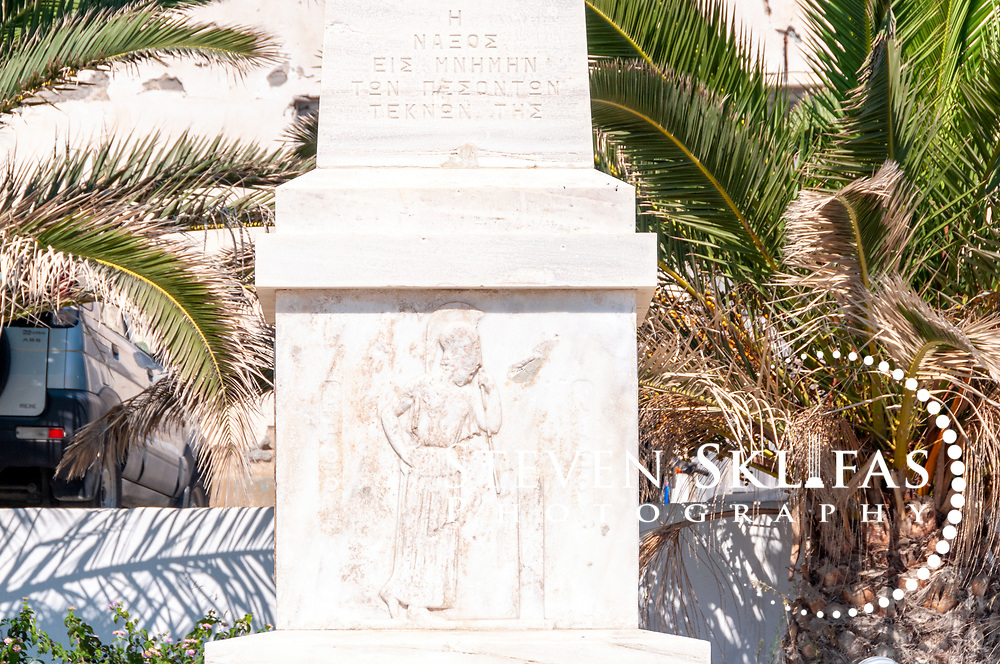Naxos. Cyclades. Greece. Obelisk monument locate on the waterfront of Naxos town (Chora).