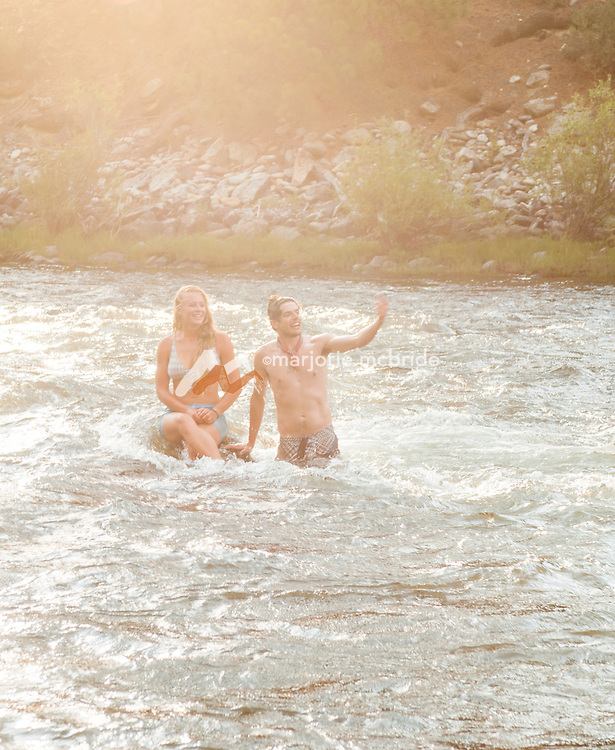Having fun and cooling off swimming in the river, Stateland Right Camp on the Middle Fork of the Salmon River, Idaho.