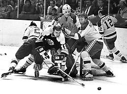California Golden Seals battle the Boston Bruins 1971 action: Bruins Wayne Carleton, Seals goalie Gary Smith helped by Dick Redmond. (photo/Ron Riesterer)