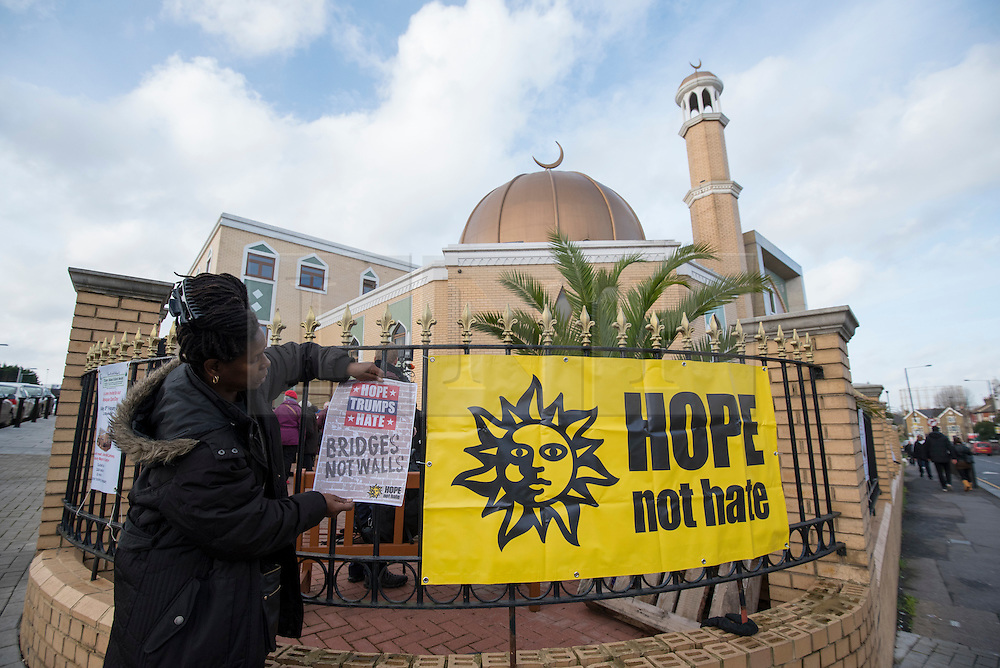 """© Licensed to London News Pictures. 03/02/2017. London, UK. A banner is placed on the railings prior to a human circle of solidarity forming outside Wightman Road mosque in north London during Friday prayers, in an event backed by a coalition of faith groups, including members of Reform Judaism, the Christian Muslim Forum and Faiths Forum for London.  The aim is to """"stand with our Muslim brothers and sisters at this time of international turbulence"""", say the organisers. Photo credit : Stephen Chung/LNP"""