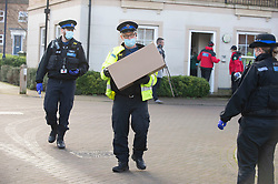 © Licensed to London News Pictures 02/02/2021.        Maidstone, UK. Police collecting tests in a box. Door to door testing for the South African variant of Covid-19 has started in the Maidstone area of Kent this afternoon. Police, Fire and NHS staff along with volunteers from Kent Search and Rescue and Kent County Council are handing out PCR tests to residents than collecting them an hour later. Photo credit:Grant Falvey/LNP