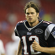 New England quarterback Tom Brady (12) leaves the field after winning an NFL football game against the Tampa Bay Buccaneers at Raymond James Stadium on Thursday, August 18, 2011 in Tampa, Florida.   (Photo/Alex Menendez)