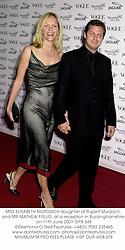 MISS ELISABETH MURDOCH daughter of Rupert Murdoch, and MR MATHEW FREUD, at a reception in Buckinghamshire on 11th June 2001.OPB 346