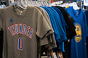 A new Kevin Durant t-shirt with the Golden State Warriors is for sale in a local sporting goods store next to Oklahoma City Thunder apparel in Durant, Oklahoma on January 27, 2017.  (Cooper Neill for The New York Times)
