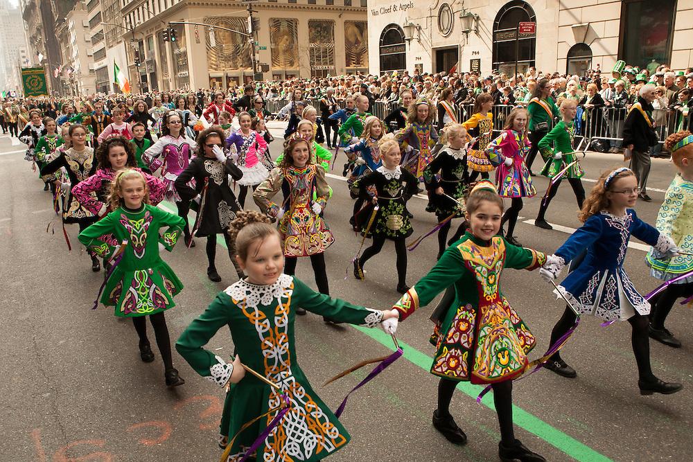 Girls from an Irish dance school parade down Fifth Avenue.