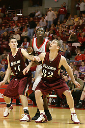 01 January 2006..Greg Dilligard gets screened during a free throw by Jordan  Armstrong and Matt Shaw...The Southern Illinois Saluki's chewed up the Illinois State Redbirds with 37 points in the 2nd half to beat the birds with a final score of 65-52.  An audience of just over 7500 watched the in Redbird Arena on the campus of Illinois State University in Normal Illinois.....