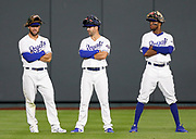 Kansas City Royals' Alex Gordon, left, Whit Merrifield, center, and Rosell Herrera, right, wait in the outfield during a pitching change in the 8th inning of a baseball game against the Chicago Cubs at Kauffman Stadium in Kansas City, Mo., Monday, Aug. 6, 2018. (AP Photo/Colin E. Braley)
