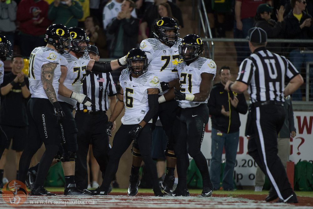 November 14, 2015; Stanford, CA, USA; Oregon Ducks wide receiver Charles Nelson (6) is congratulated for scoring a touchdown against the Stanford Cardinal during the first quarter at Stanford Stadium.