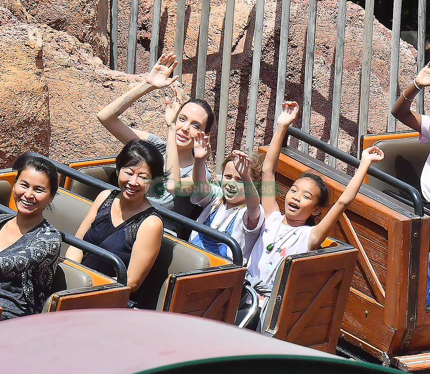 EXCLUSIVE: PREMIUM RATES APPLY Angelina Jolie celebrates Shilo's 11th birthday with an incredibly fun day at Disneyland. The mother and daughter pair were joined by Angie's other kids Knox, Vivian and Zahara, and a group of friends visiting from Cambodia. The group celebrated with Birthday Churros and riding rides including Space Mountain, Thunder Mountain, the Teacups, Alice in wonderland, small world, the matterhorn, and many other of the park's attractions. 26 May 2017 Pictured: Angelina Jolie, Shiloh, Knox, Vivian, Zahara. Photo credit: Snorlax/ MEGA TheMegaAgency.com +1 888 505 6342
