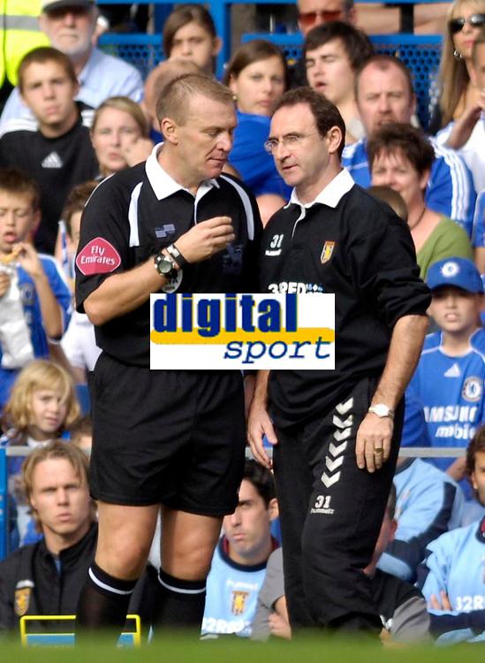 Photo: Daniel Hambury.<br />Chelsea v Aston Villa. The Barclays Premiership. 30/09/2006.<br />Villa's manager Martin O' Neill (R) is told to calm down by referee Graham Poll.