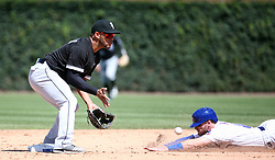 July 25, 2017 - Chicago, Illinois, USA - The Chicago Cubs' Ian Happ steals second base ahead of the throw to Chicago White Sox second baseman Yoan Moncada, left, in the fifth inning at Wrigley Field in Chicago. The Cubs won, 7-2. (Credit Image: © Brian Cassella/TNS via ZUMA Wire)