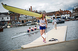 © London News Pictures. 03/07/2013.  Henley-on-Thames, UK.  Pippa Whitaker leaving the water after competing on Day one of Henley Royal Regatta on the River Thames at Henley-on-Thames, Oxfordshire on July 03, 2013. Photo credit: Ben Cawthra/LNP