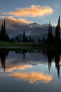 Mount Rainier silhouetted above the clouds during a sunset at Upper Tipsoo Lake in Mount Rainier National Park, Washington State, USA