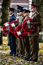 Members of the military hold poppy wreaths during a Remembrance Sunday service in Queen's Square, Bristol, held in tribute for members of the armed forces who have died in major conflicts.