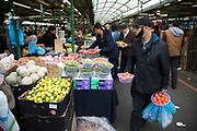 Multicultural scene at the Bullring Open Market, an outdoor food market in central Birmingham, United Kingdom. The Open Market offers a huge variety of fresh fruit and vegetables, fabrics, household items and seasonal goods. The Bull Ring Open Market has 130 stalls.