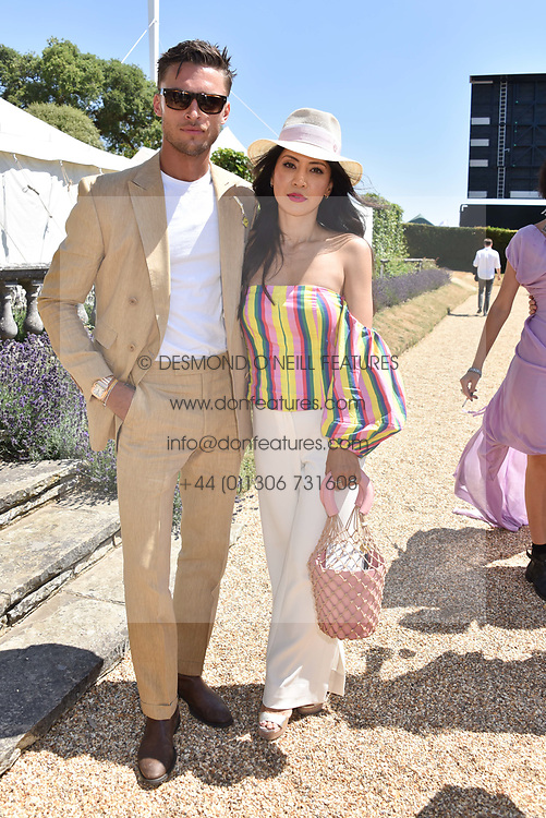 Harvey Newton Hayden and Vicky Lee at the 'Cartier Style et Luxe' enclosure during the Goodwood Festival of Speed, Goodwood House, West Sussex, England. 15 July 2018.