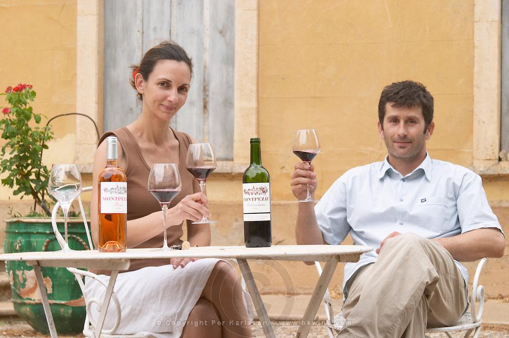 Christophe Blanc and his wife Chateau de Montpezat. Pezenas region. Languedoc. Owner winemaker. Tasting wine. France. Europe. Bottle.