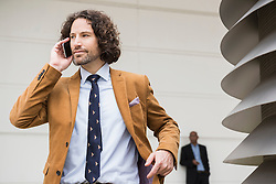 Businessman suit brown cell phone talking