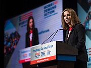 10 AUGUST 2019 - DES MOINES, IOWA: SHANNON WATTS, founder of Moms Demand Action for Gun Sense in America, welcomes people to the Presidential Gun Sense Forum. Several thousand people from as far away as Milwaukee, WI, and Chicago, came to Des Moines Saturday for the Presidential Gun Sense Forum. Most of the Democratic candidates for president attended the event, which was organized by Moms Demand Action, Every Town for Gun Safety, and Students Demand Action.          PHOTO BY JACK KURTZ