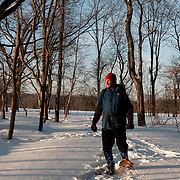Man on snowshoes at Moose Hill Farm, Sharon, Massachusetts
