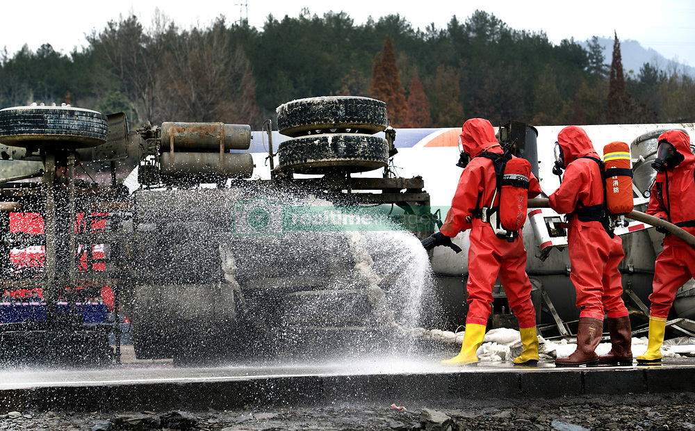 November 20, 2018 - Hanzhong City, China - Rescuers take part in an emergency exercise simulating hazardous chemicals transportation accident at Ningqiang County of Hanzhong City, northwest China's Shaanxi Province, Nov. 20, 2018. The exercise was conducted to help enhance capabilities to respond to the emergency. (Credit Image: © Tao Ming/Xinhua via ZUMA Wire)