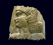 Head of a eunuch wearing a red headband.  This derives from a scene showing courtiers attending the king.  The unusually high relief of the sculpture may be due to the employment of craftsmen from the western provinces of the empire.  About 710-705 BC, from the Palace of Sargon 11, Khorsabad.