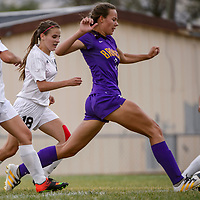 Kirtland Central Bronco Rebecca James (7) sprints ahead of the Grants Pirate defense Thursday at Grants High School.