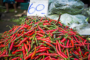 """26 SEPTEMBER 2012 - BANGKOK, THAILAND:  Hot chilli peppers for sale in Khlong Toey Market in Bangkok. Khlong Toey (also called Khlong Toei) Market is one of the largest """"wet markets"""" in Thailand. The market is located in the midst of one of Bangkok's largest slum areas and close to the city's original deep water port. Thousands of people live in the neighboring slum area. Thousands more shop in the sprawling market for fresh fruits and vegetables as well meat, fish and poultry.    PHOTO BY JACK KURTZ"""