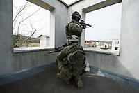 """03 APR 2012, LEHNIN/GERMANY:<br /> Scharfschuetzen """"Sniper"""" sichern das Vorruecken Ihrer Kammeraden, Kampfschwimmer der Bundeswehr trainieren """"an Land"""" infanteristische Kampf, hier Haeuserkampf- und Geiselbefreiungsszenarien auf einem Truppenuebungsplatz<br /> IMAGE: 20120403-01-042<br /> KEYWORDS: Marine, Bundesmarine, Soldat, Soldaten, Armee, Streitkraefte, Spezialkraefte, Spezialkräfte, Kommandoeinsatz, Übung, Uebung, Training, Spezialisierten Einsatzkraeften Marine, Waffentaucher"""
