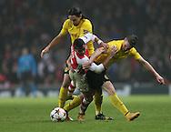 Arsenal's Alexis Sanchez tussles with Dortmund's Neven Subotic and Kevin Grosskreutz<br /> <br /> UEFA Champions League- Arsenal vs Borussia Dortmund- Emirates Stadium - England - 26th November 2014 - Picture David Klein/Sportimage