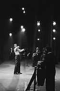 Paris.1958.<br /> Harry Belafonte rehearsing on the stage of the Palais de Chaillot before his concert.<br /> <br /> <br /> Paris.1958 .<br /> Harry Belafonte répete sur la scène du Palais de Chaillot avant son concert