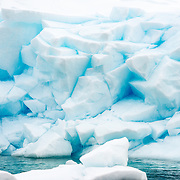 Large blocks of glacier ice reaches down to the water at Paradise Harbor one the western side of the Antarctic Peninsula.