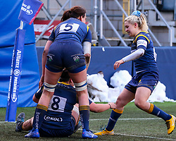 Sioned Harries, captain of Worcester Warriors Women,  is congratulated after scoring a try by Elizabeth Shermer and Brooke Bradley  - Mandatory by-line: Nick Browning/JMP - 09/01/2021 - RUGBY - Sixways Stadium - Worcester, England - Worcester Warriors Women v DMP Durham Sharks - Allianz Premier 15s