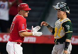 August 30, 2017 - Anaheim, CA, USA - The Los Angeles Angels Mike Trout celebrates his solo home run in front of Oakland catcher Bruce Maxwell in the first inning against the Oakland Athletics at Angel Stadium in Anaheim, CA on Wednesday, August 30, 2017. (Photo by Kevin Sullivan, Orange County Register/SCNG) (Credit Image: © Kevin Sullivan/The Orange County Register via ZUMA Wire)