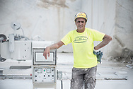 In the marble basin of Vagli, in the interior area of ​​the land of marble. The  work is now highly technical and mandatory is clothing with high visibility