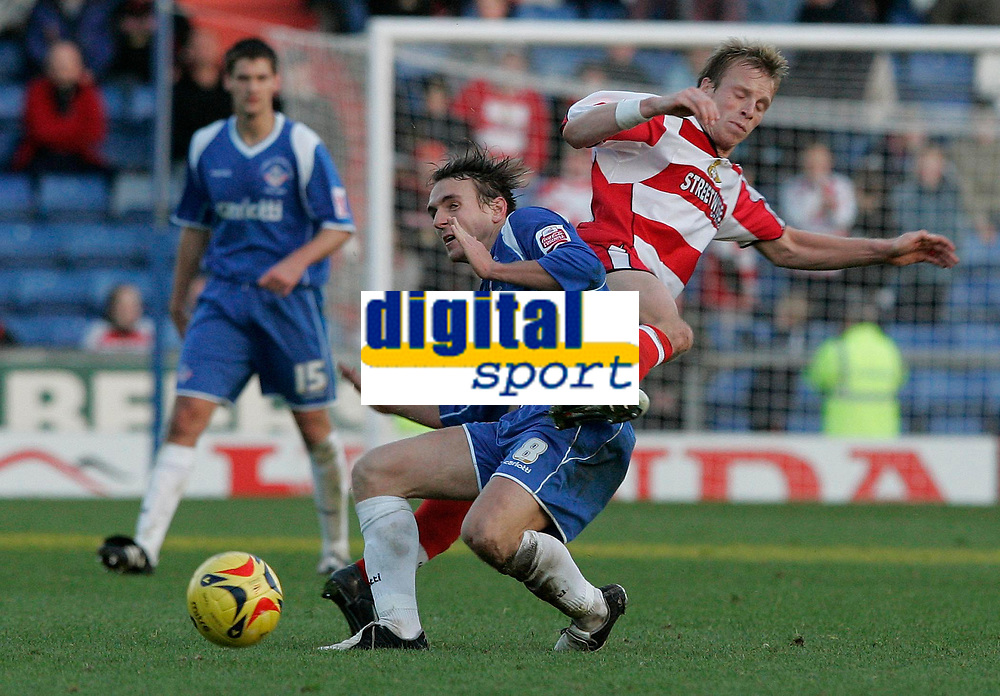 Photo: Dave Howarth.<br />Oldham Athletic v Doncaster Rovers. Coca Cola League 1.<br />13/11/2005.  Doncaster's Ricky Ravenhill tries to get round Oldham's Mark Hughes