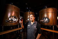 Roger Bott, brewer and owner at The Lab Brewery, poses by the bright tanks where beer gets finished inside of Twisted Oak Tavern restaurant in Agoura Hills, CA.  November 6, 2015. Photo by David Sprague