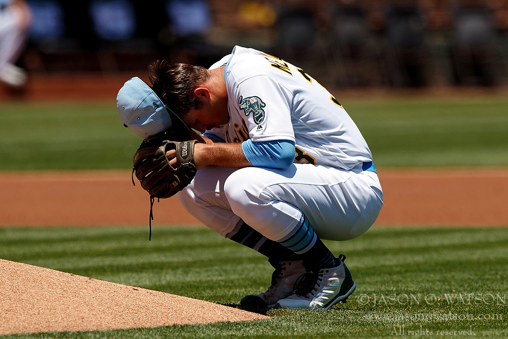 OAKLAND, CA - JUNE 17:  Daniel Mengden #33 of the Oakland Athletics kneels behind the pitchers mound during the first inning against the Los Angeles Angels of Anaheim at the Oakland Coliseum on June 17, 2018 in Oakland, California. The Oakland Athletics defeated the Los Angeles Angels of Anaheim 6-5 in 11 innings. (Photo by Jason O. Watson/Getty Images) *** Local Caption *** Daniel Mengden