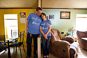 NORTH FREEDOM — October 6, 2014: SaDonna Oakley, right, stands with her husband, Joe, in their North Freedom trailer park home. Oakley was diagnosed with Stage IV colon cancer in May 2014 and went into surgery early morning on Tuesday, October 7 at St Mary's Hospital in Madison.<br /> <br /> Ben Brewer for the New York Times