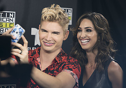 October 3, 2016 - Hollywood, California, U.S - Christian Acosta and Erika Csiszer at Telemundo's Latin American Music Awards Press Conference after their rehearsal at the Dolby Theatre on Monday October 3, 2016 in Hollywood, California. (Credit Image: © Prensa Internacional via ZUMA Wire)