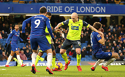 Huddersfield Town's Aaron Mooy (centre) in action
