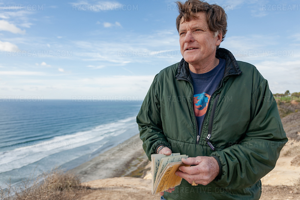 Portrait of paddler Ed Gillet holding the journal he kept while at sea during a 64 day, 2,200 mile kayak crossing from Monterey, CA to Maui, HI. Photo © Robert Zaleski / rzcreative.com<br />  —<br /> To license this image contact: robert@rzcreative.com
