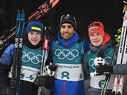 PYEONGCHANG, Feb. 12, 2018  Champion Martin Fourcade (C) from France, second-placed Sebastian Samuelsson (L) from Sweden and third-placed Benedikt Doll from Germany pose for photos during venue ceremony of men's 12.5km pursuit event of biathlon at 2018 PyeongChang Winter Olympic Games at Alpensia Biathlon Centre, Feb. 12, 2018. (Credit Image: © Wang Haofei/Xinhua via ZUMA Wire)