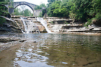 """cascate della Brusia waterfalls with medieval bridge called """"a schena d'asino"""" (donkey back)."""