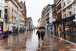 Glasgow, Scotland, UK. 21 November 2020. Views of Saturday afternoon in Glasgow city centre on first day of level 4 lockdown. Non essential shops and businesses have closed and streets are very quiet. Pictured;  Buchanan Street shopping precinct is almost deserted with no shops open .Iain Masterton/Alamy Live News