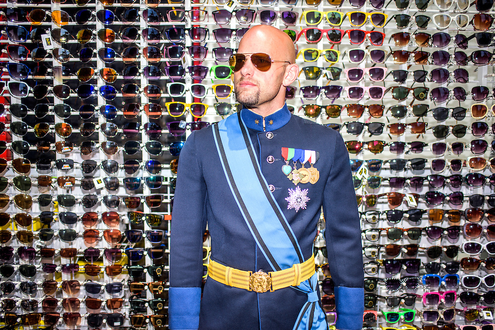 """Hollywood, California - April 10, 2015: Grand Duke Travis of WestArctica stops for a portrait during a pre-MicroCon 2015 tour of the Hollywood Walk of Fame, Friday April 10, 2015. <br /> <br /> The claimed territory of WestArctica is the Marie Byrd Land of Antarctica, which is 1/8th of the continent. Last year Grand Duke Travis (Travis McHenry) registered WestArctica as a non-profit. It's mission is to bring attention to climate change's impact on Antarctica's ice sheets and advocate for the local penguin population. Grand Duke Travis founded WestArctica November 2, 2001 while he was in the Navy as an Intelligence Specialist. His advocacy work with WestArctica led him to speak with dignitaries from other countries. The Navy found out, and gave him an ultimatum. So, his work with WestArctica took a backseat until he was honorably discharged in 2008. Since then he established a second micronation, Calsahara. It's a swath of land in the high plains of the California Valley, which his ex-wife's family owns. After Travis came out as gay, he and his wife divorced. While Travis and his ex-wife remain on good terms, according to Travis, her family is not interested in handing over their land to Travis. He did, however, name their son Nicholas, King of CalSahara, and Travis is CalSahara's """"Dictator for Life.""""<br /> <br /> CREDIT: Matt Roth"""