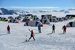"""© Licensed to London News Pictures. Union Glacier, Antarctica. LAUREN JONES from Perth, Australia bowling. Competitors from the Antarctic Ice Marathon play a game of impromptu """"Ashes"""" cricket at the Union Glacier camp, Antarctica ahead of the 2013 Antarctic Ice Marathon, which takes place  just a few hundred miles from the South Pole at the foot of the Ellsworth Mountains.. The majority of players were either Australian and English. It was declared a sporting draw. Photo credit: Mike King/LNP"""