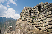 A stone wall still stands, masterfully built by the Inca to fit around a naturally occurring boulder, in Machu Picchu, Peru on September 21, 2005.